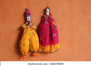 Indian traditional dolls on the wall in Jaipur.