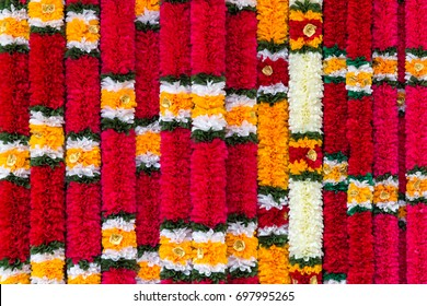 Indian traditional flower garlands used as offerings in Hindu religious ceremonies. Background