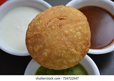 Indian traditional fried food kachori with chutneys.