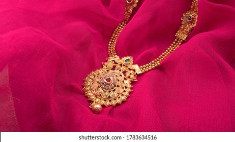 Indian Traditional gold Jewellery on beautiful background.