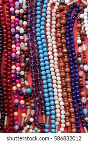 Indian traditional handicraft (glassbeads) on the street market, Arambol, Goa, India
