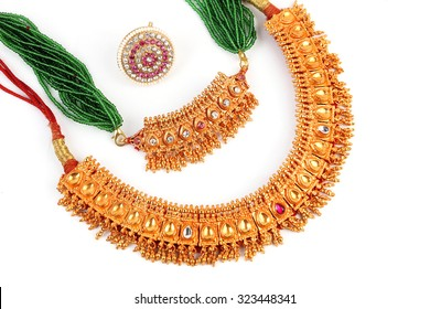 Indian Traditional jewellery necklace & Forehead Rakhadi isolated on white