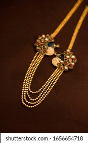 Indian Traditional Jewellery Necklace or pendant with earrings on dark background.