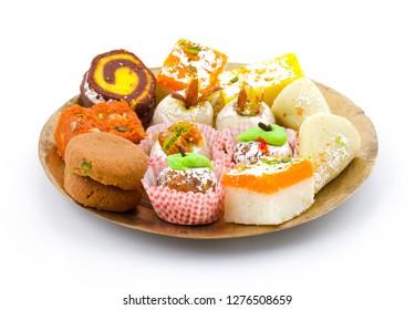 Indian Traditional Mix Sweet Food or Mix Mithai include Peda, Mawa Burfi, Dry Fruits Sweet, Halwa or Coconut Burfi