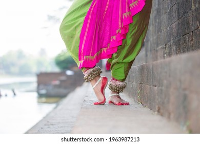 Indian Traditional odissi dance feet with ankle bells called ghungroo, Alta(Red Dye) at Bindu Sagar, Bhubaneswar, Odisha, India.