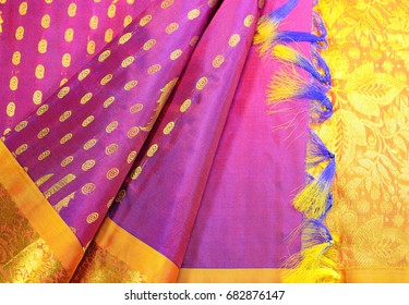 Indian traditional pink silk sari with yellow and gold border.