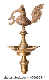 indian traditional samai or samayee, a typical shape of diya usually made up of brass, lit using cotton thread dipped in oil where we worship god at home or temple, isolated over plain background