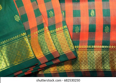 Indian traditional silk sari with orange and green checked design.