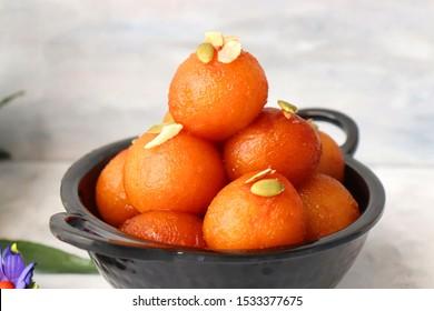 Indian Traditional Special Sweet Food or dessert Gulab Jamun or Gulabjam. Dussehra, Diwali, Holi, Ganesh Chaturthi, Makar sankranti, Onam, Shivratri festivals food. along with copy space