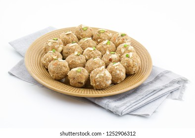 Indian Traditional Sweet Food Urad Dal Laddu Also Know as Laddoo, Ladoo, Laddo are Ball-Shaped Sweets Made of Butter, Dry Fruits, Fenugreek and other Spices. Urad Dal laddu Sweet Mostly Eat in Winter