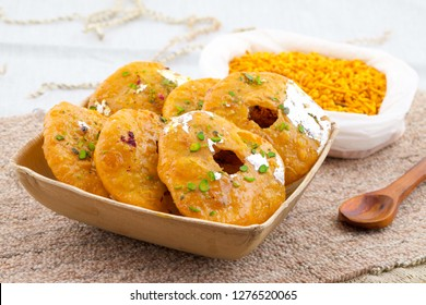 Indian Traditional Sweet Kachori Also Know As Mawa Kachori, Kachauri or Kachodi, Stuffed Kachori With Condensed Milk, Cheese and Dry Fruits And Served With Sugar Syrup