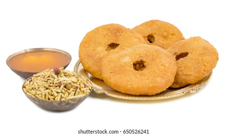 Indian Traditional Sweet Kachori Also Know As Mawa Kachori, Kachauri or Kachodi, Stuffed Kachori With Condensed Milk, Cheese and Dry Fruits And Served With Sugar Syrup isolated on White Background