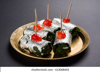 Indian traditional sweet Masala Paan which helps in digestion and is a mouth freshner. Group photo of flavoured and coated Sauf, tutti frutti, supari, clove, gulqand, coconut powder etc