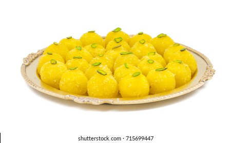 Indian Traditional Yellow Sweet Food Coconut Laddoo Also Know As Coconut Laddu, Ladoo, laddo Are Ball-Shaped Sweets. Isolated on White Background