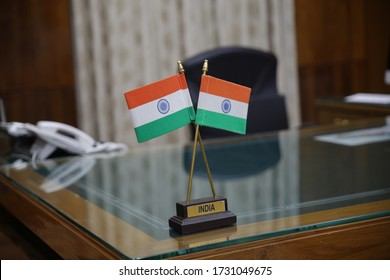 Indian tricolor flag placed on the executive table of a powerful government officer.