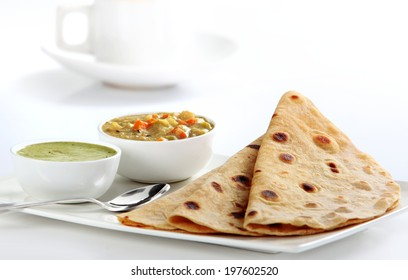 Indian Vegetable Curry and Chapati - Homemade chapati (Indian bread) served with delicious Indian vegetable curry.