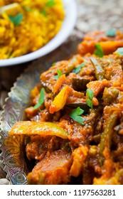 Indian Vegetable Curry-  Vegetarian Sabzi Cuisine-  Asian cuisine vegetarian or vegan popular dish -  tomato, potato, okra, cauliflower, sweet potato, butternut squash, green peas and chilli pepper