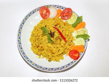 Indian vegetable fried rice (pulao) served with salad isolated on white background