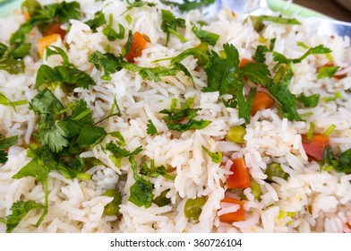 The Indian vegetable pulao is rice seasoned with vegetables and spices and is a healthy comfort food served with many meals