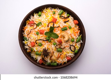 Indian Vegetable Pulav or Biryani made using Basmati Rice, served in a wooden bowl. selective focus