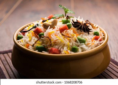 Indian Vegetable Pulav or Biryani made using Basmati Rice, served in a ceramic bowl. selective focus