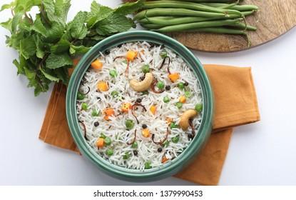 Indian Vegetable Pulav or Biryani made using Basmati Rice, served in bowl
