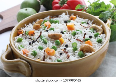 Indian Vegetable Pulav or Biryani made using Basmati Rice, served in bowl