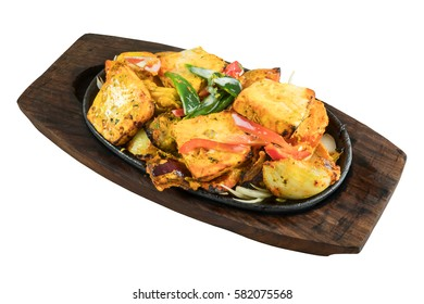 Indian vegetarian dish paneer shashlik with red and green peppers grilled in tandoor isolated from background