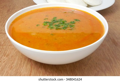 Indian vegetarian liquid food sambar or curry in a bowl. This food is usually consumed with idli, a steam-cooked rice cake.