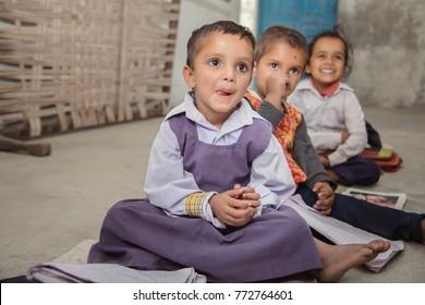 A Indian village school girls looking at blackboard.