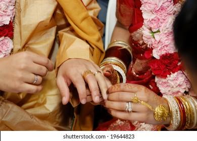 Indian wedding couple exchanging rings