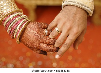 Indian wedding couple hand in hand showing ring