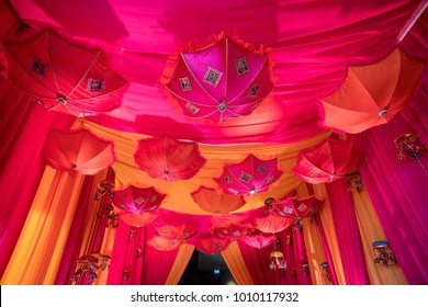 Indian wedding hall decoration. Pink and yellow theme.
