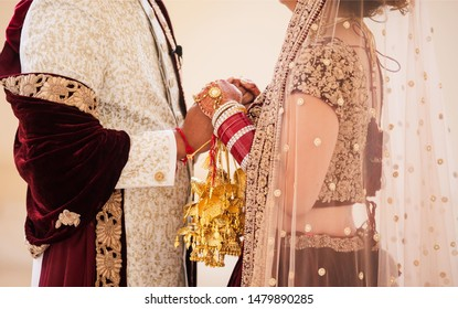 Indian wedding lovebirds holding hands first look at their wedding day