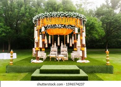 Indian wedding mandap decor yellow and white flowers