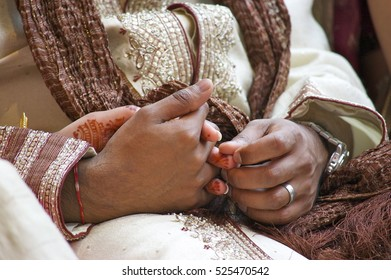 Indian Wedding - Married couple holding hands