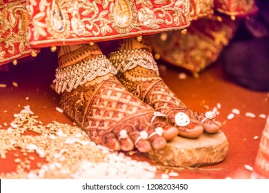 An Indian Wedding Ritual. Indian wedding. Henna mehndi on bride.