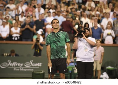 INDIAN WELLS - MARCH 12:  Roger Federer hits ball so the fans after beating Stephane Robert in round 2 at the BNP Paribas Open on March 12, 2017 in Indian Wells, CA.