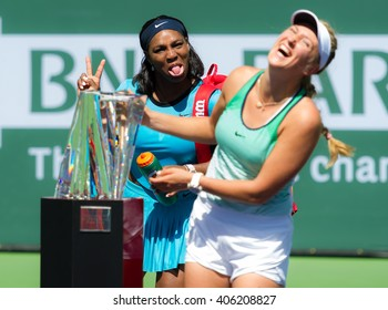 INDIAN WELLS, UNITED STATES - MARCH 20 : Serena Williams photobombs Vika during the 2016 BNP Paribas Open trophy ceremony