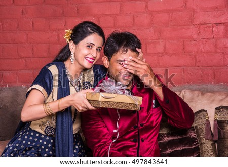 Indian Wife Surprising Husband With A Gift On Diwali Or Anniversary Birthday While Closing His
