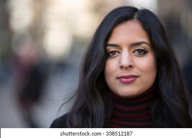Indian woman in city neutral face portrait