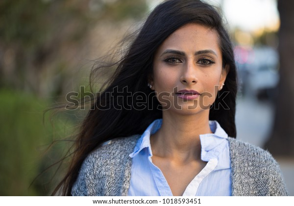 Indian woman in city serious face portrait