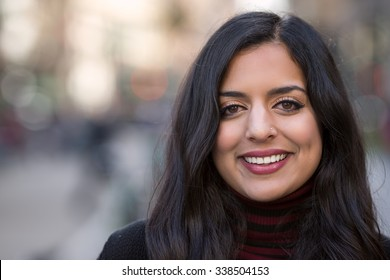Indian woman in city smile happy face portrait