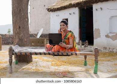 Indian woman doing online shopping at home