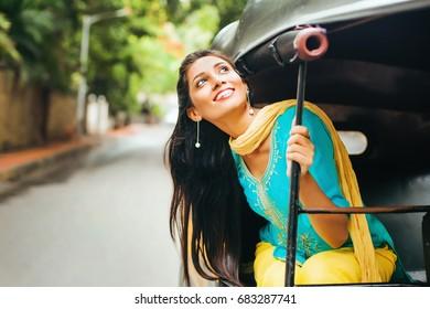 indian woman enjoying in rickshaw