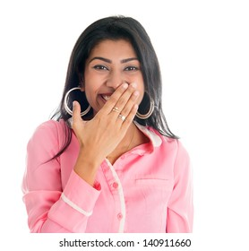 Indian woman giggles covering her mouth with hand, portrait of beautiful Asian female model isolated on white
