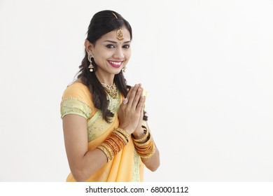 Indian woman in glamorous traditional clothing greeting