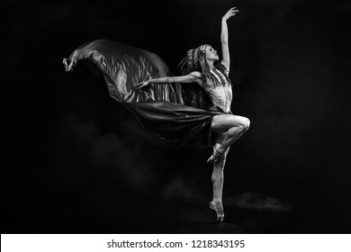 Indian woman, Glamour, classic ballet dancer with indian feathers plume dancing with elegance