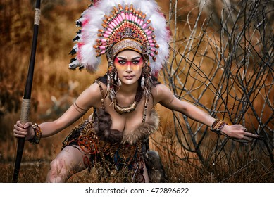 Indian woman hunter Native American in the jungle.
