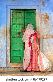 Indian woman knocking on the door